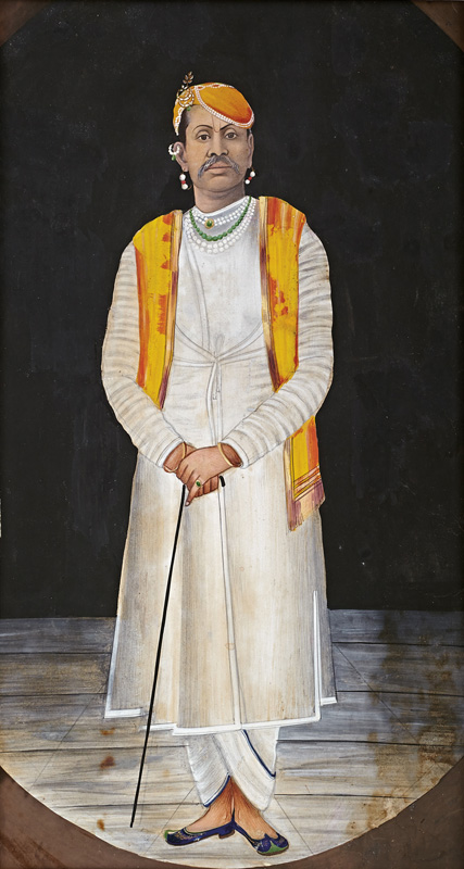 Full length portrait of Govardhanlalji standing with cane