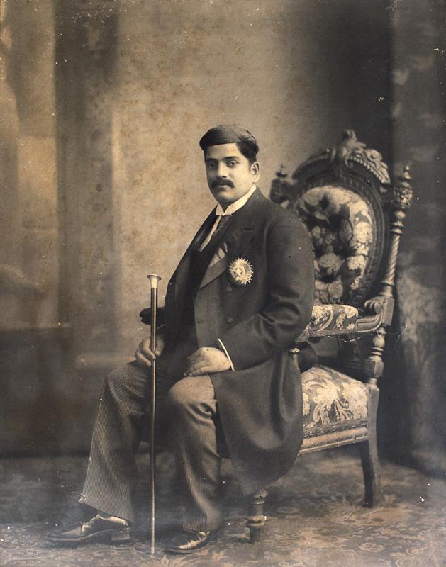 Sir Sayajirao Gaekwad III on a Victorian chair