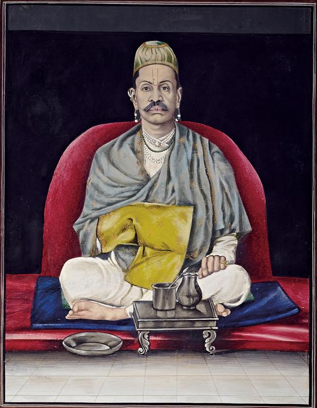 Govardhanlalji sitting in prayer, holding a Rosary Bag